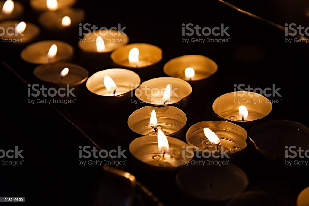 Candles in a dark church stock photo