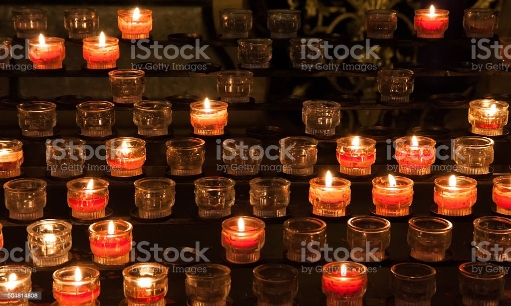 Candles in church stock photo