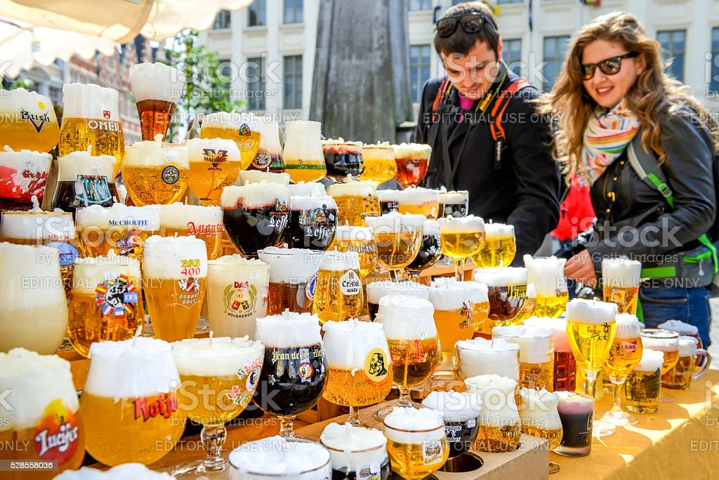 Candles in form of traditional glasses of Belgium beer stock photo