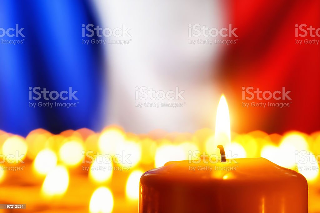 Candles in front of the France flag stock photo