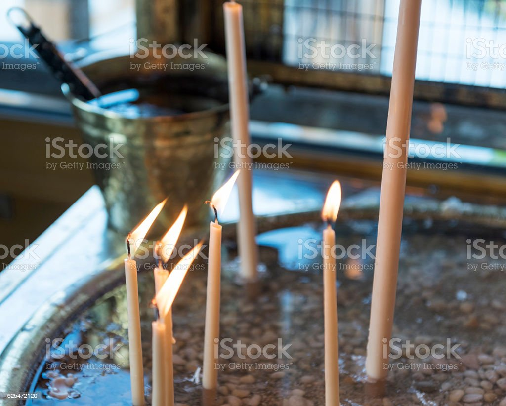 Candles in Panagia Pantanassa in Porto Lagos, Greece stock photo