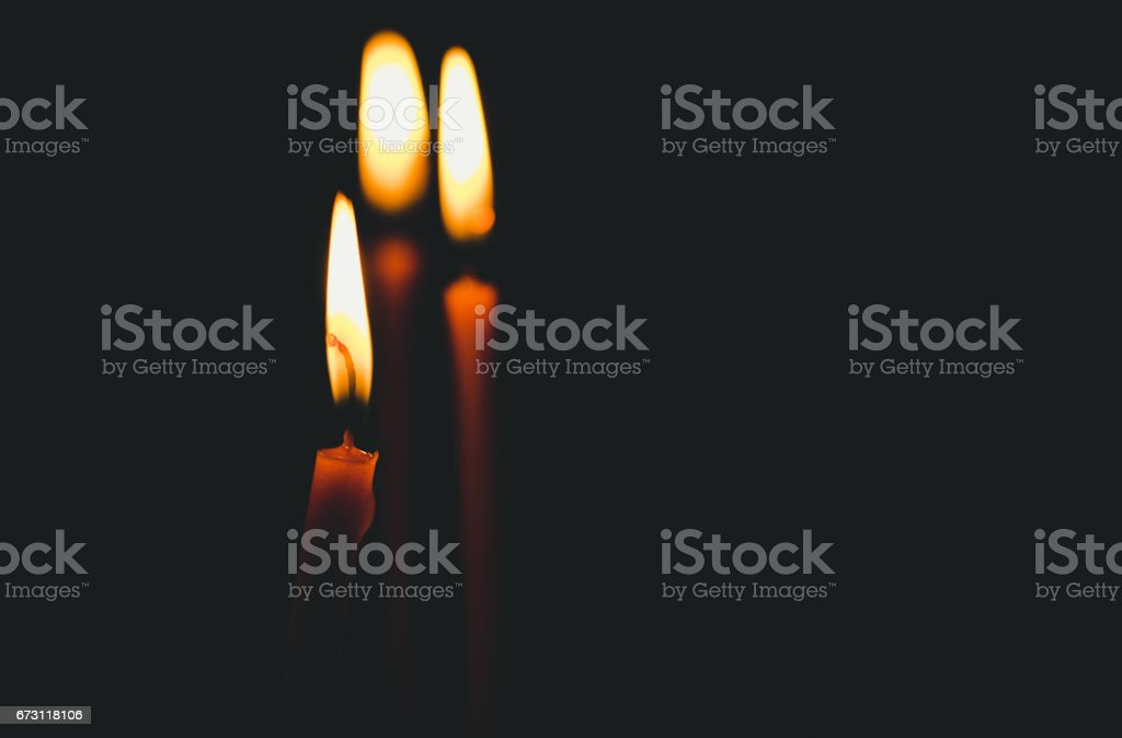 Candles in the church. Light in the dark. stock photo