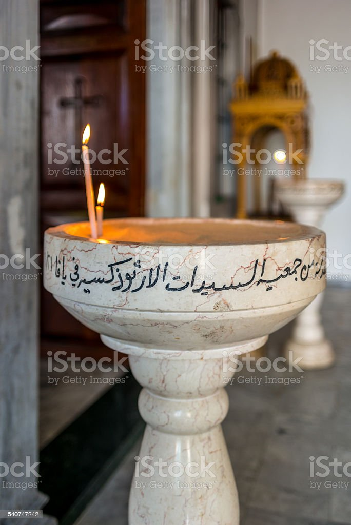Candles in the Orthodox Monastery of St. Michael in Jaffa stock photo