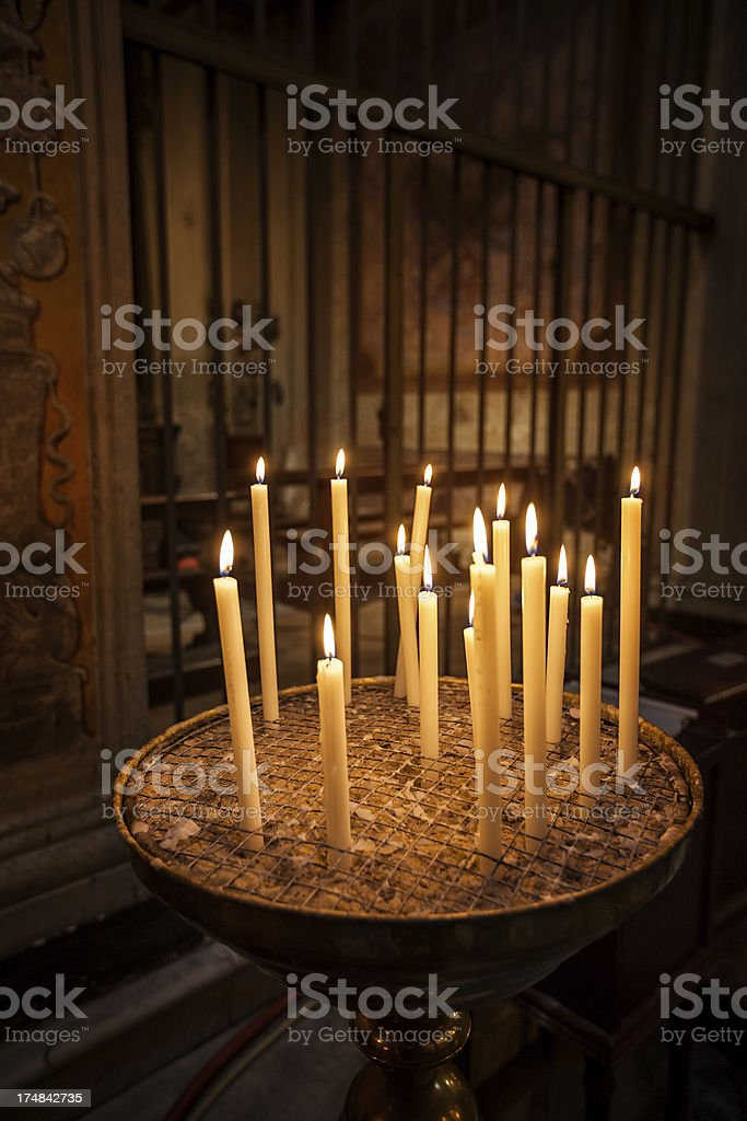 Candles inside a church in Rome royalty-free stock photo