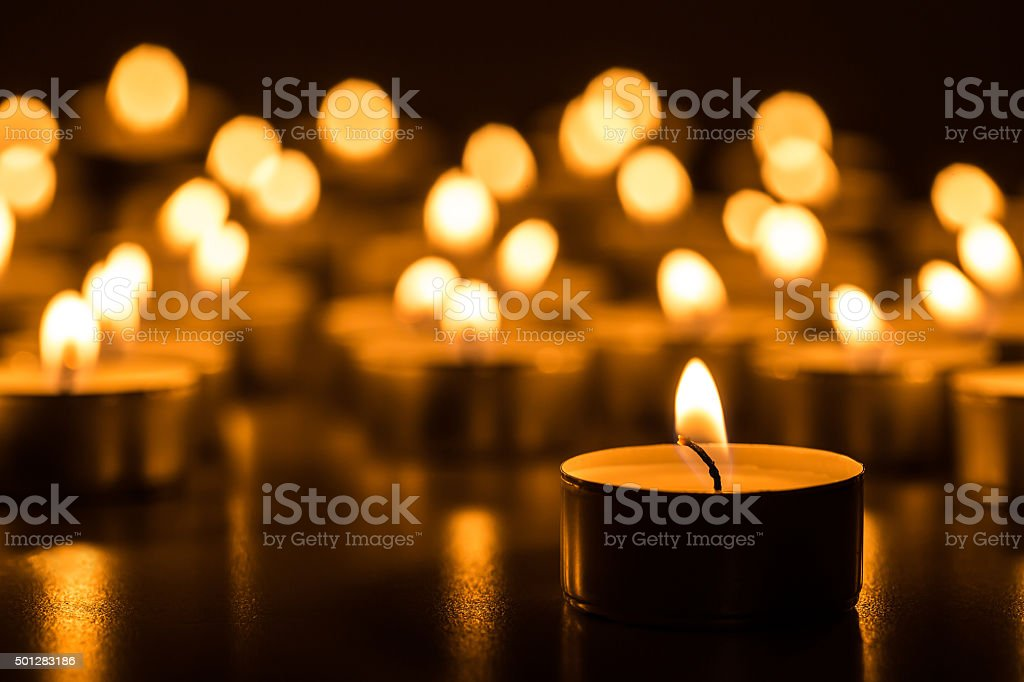 Candles light. Christmas candles burning at night. stock photo