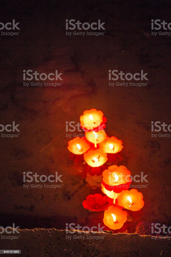 Candles lighted in river, China stock photo