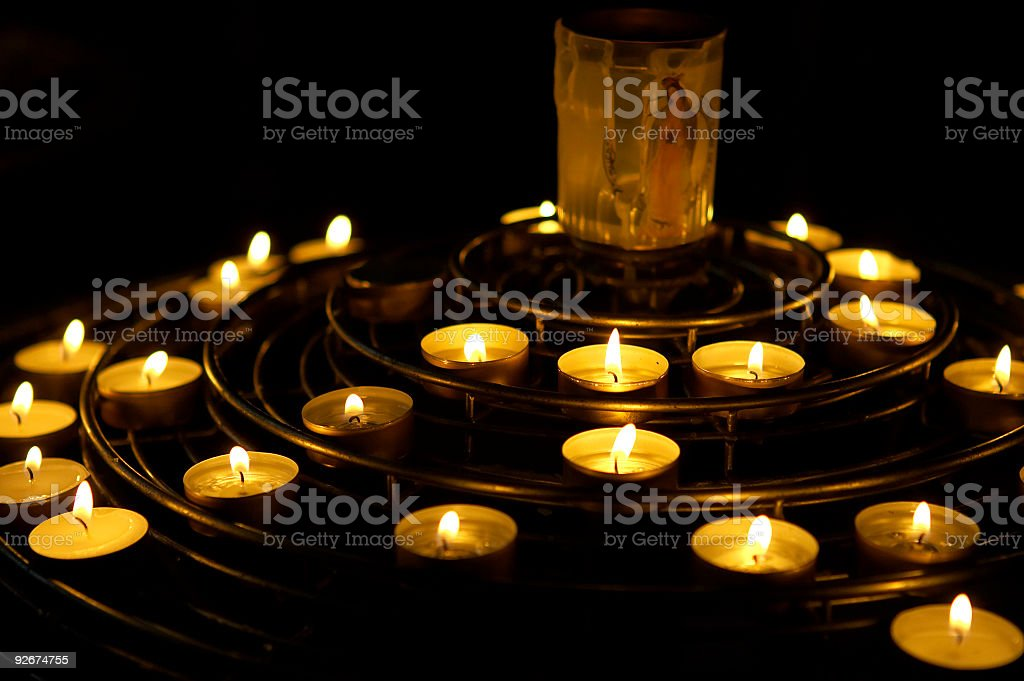 Candles lit as a prayer royalty-free stock photo
