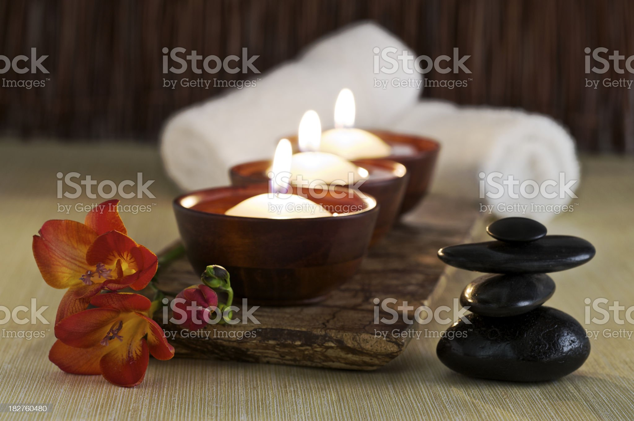 Candles, Massage Stones and Flower in Zen Spa royalty-free stock photo