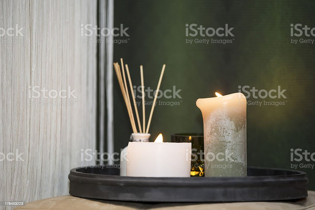 Candles next to bed stock photo