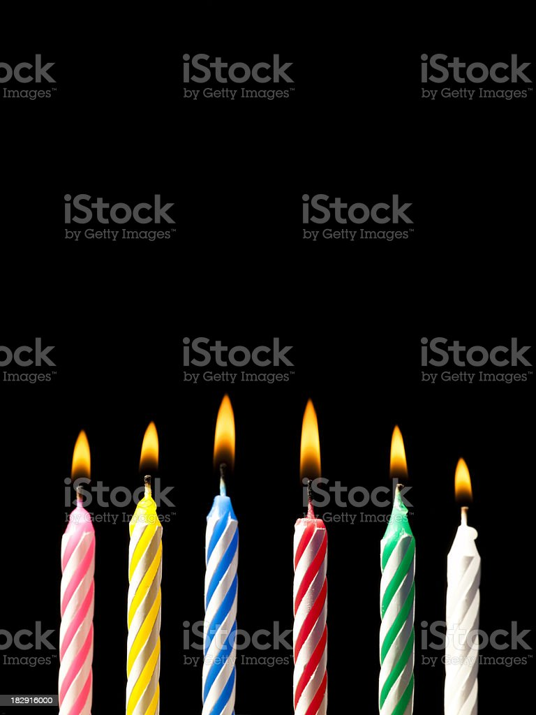 Candles on a birthday cake royalty-free stock photo
