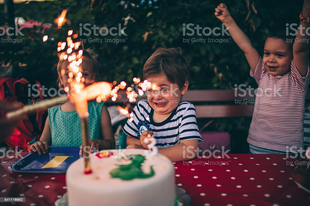 Candles on a birthday cake stock photo