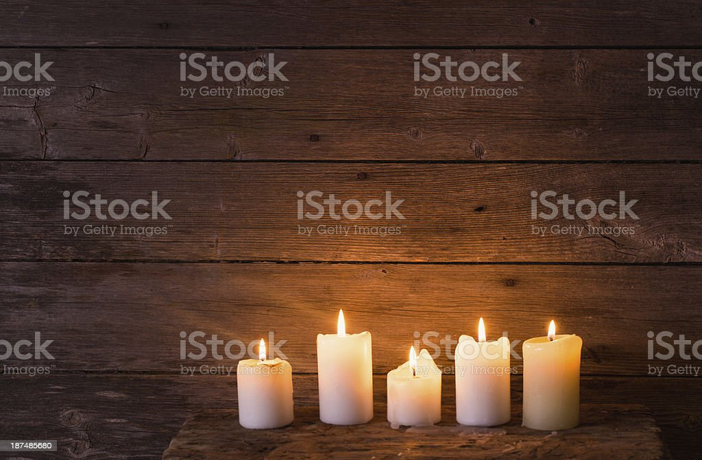 candles on old wooden background stock photo