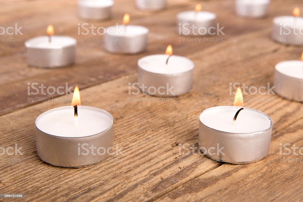 Candles on wooden background stock photo