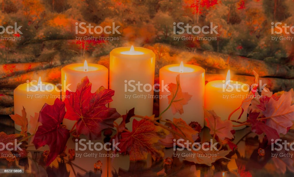 Candles with Autumn leaves reflected and glowing (P) stock photo
