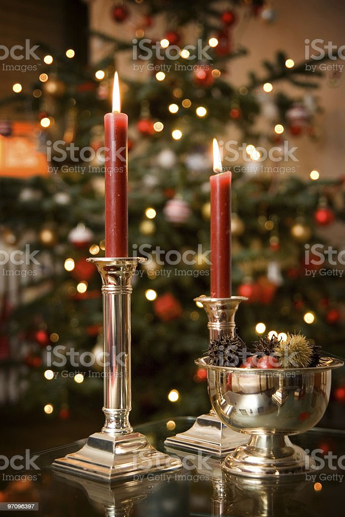 Candles with Christmas Tree in Background royalty-free stock photo