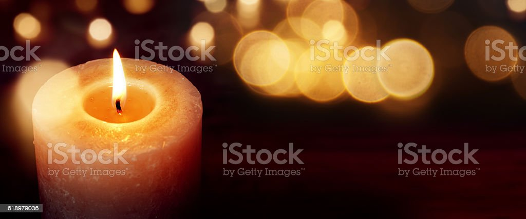 Candles with golden lights stock photo