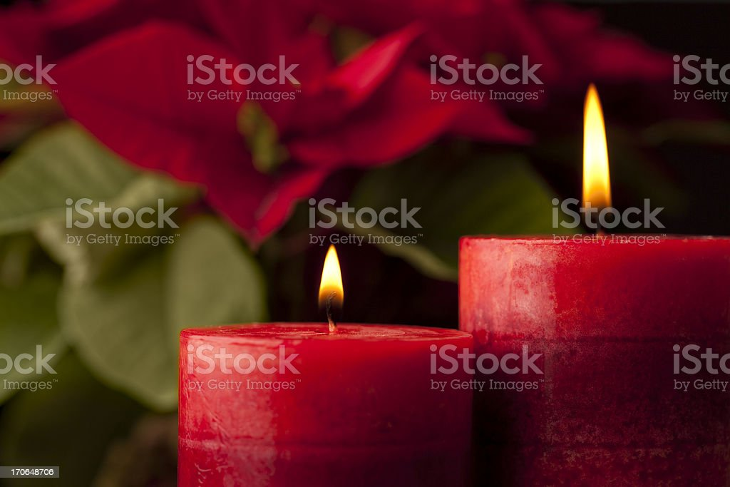Candles with Poinsettia in Background stock photo