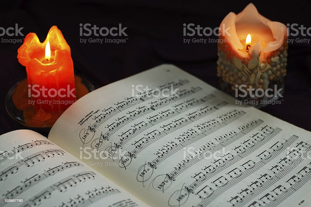candles with sheet music royalty-free stock photo