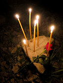 Candles with the rose on the stone