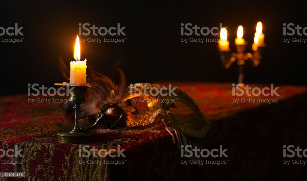 candlestick and Venetian mask stock photo