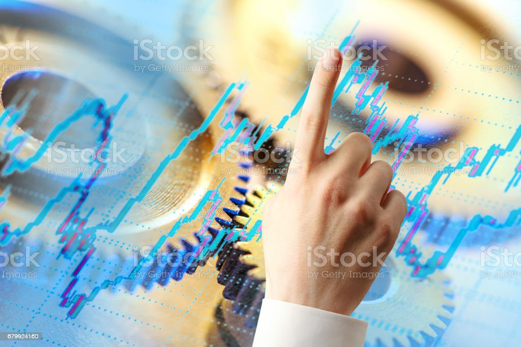 Candlestick chart, ratchets and hand stock photo