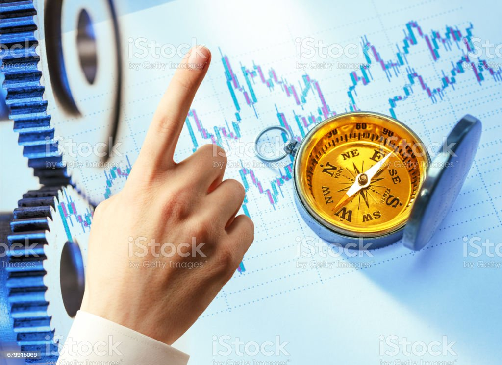 Candlestick graph chart, hand and compass stock photo