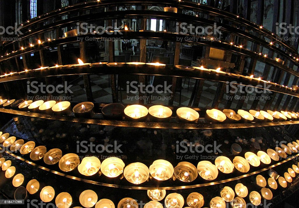 candlestick in church with many wax candles stock photo