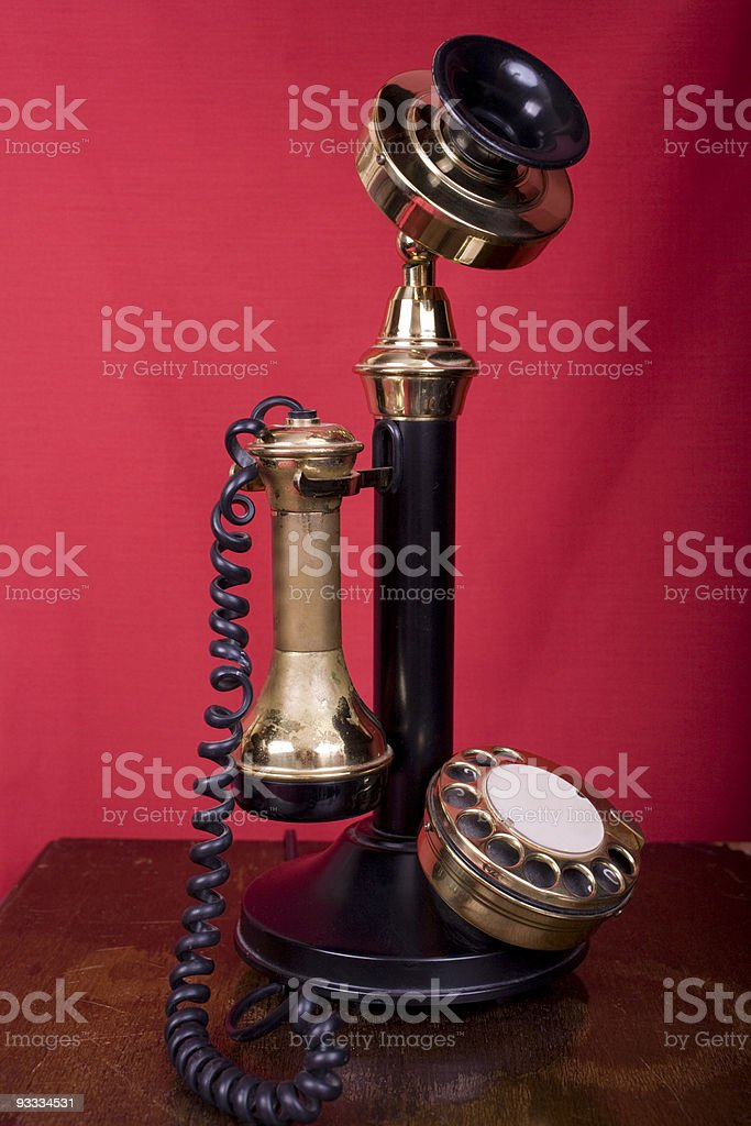 Candlestick Telephone on Table stock photo