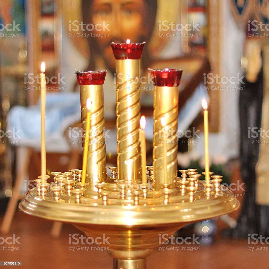 candlesticks in the church stock photo