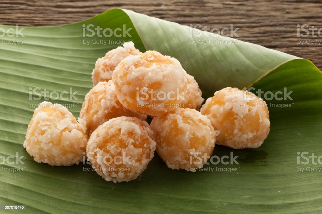 Candy Akehgss on banana leaf vintage wooden stock photo