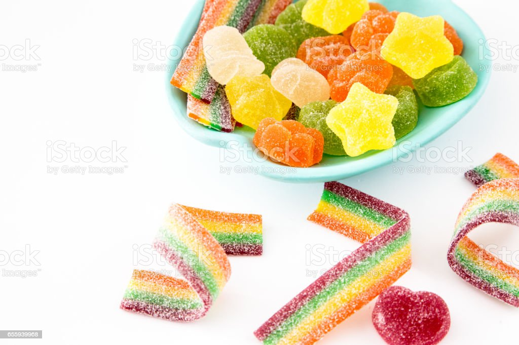 Candy background. Colorful candies in plate on light background stock photo