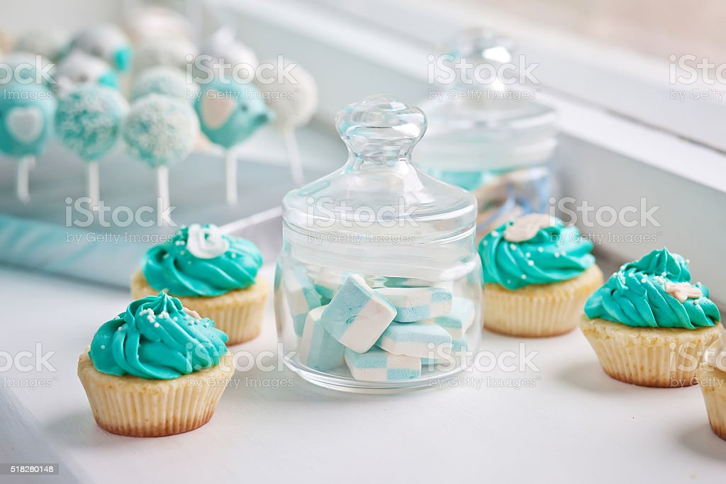 Candy bar at Birthday party.Marshmallows in a glass and cupcakes stock photo