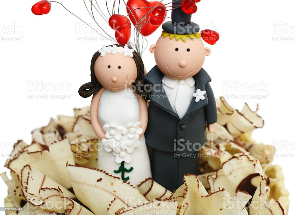 Candy bride and groom on top of a wedding cake royalty-free stock photo