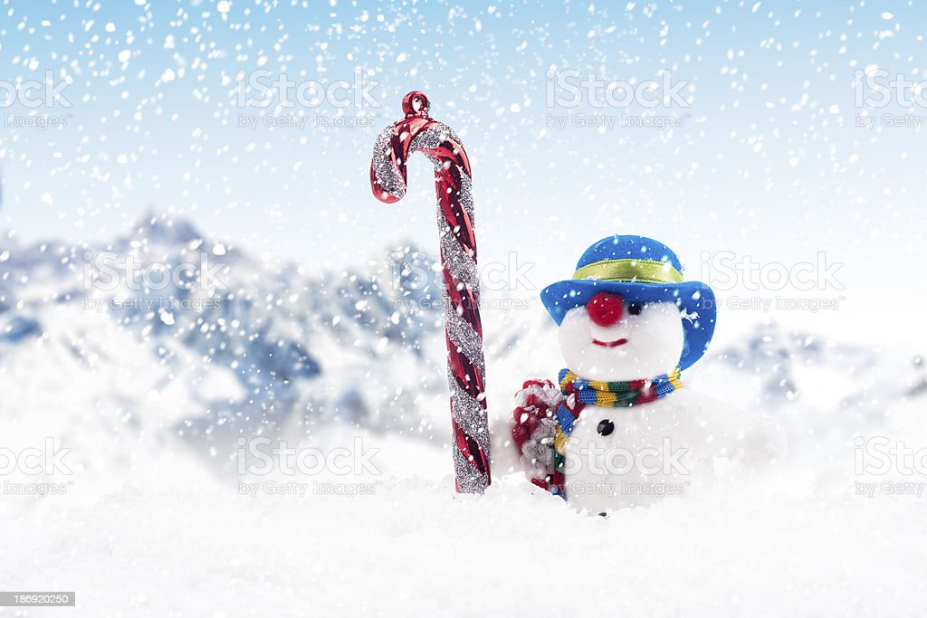 Candy cane and snow man for Christmas royalty-free stock photo