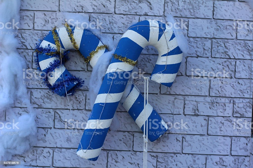 Candy cane with pretty holly leaves and bow stock photo