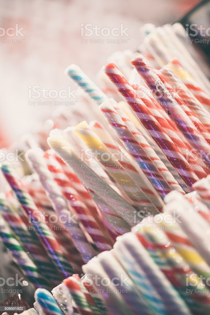 Candy canes in sweets stand stock photo