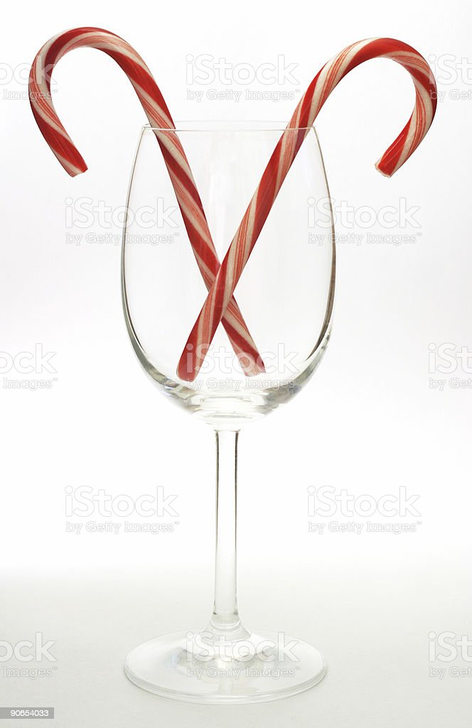 Candy canes in wine glass royalty-free stock photo