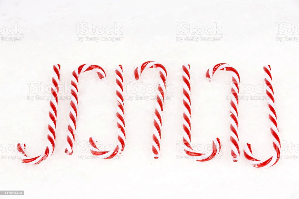 Candy Canes on Artificial Snow Background, Holiday Decoration royalty-free stock photo