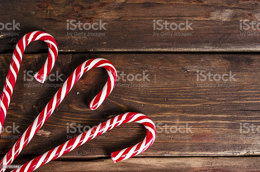 candy canes on wooden boards royalty-free stock photo