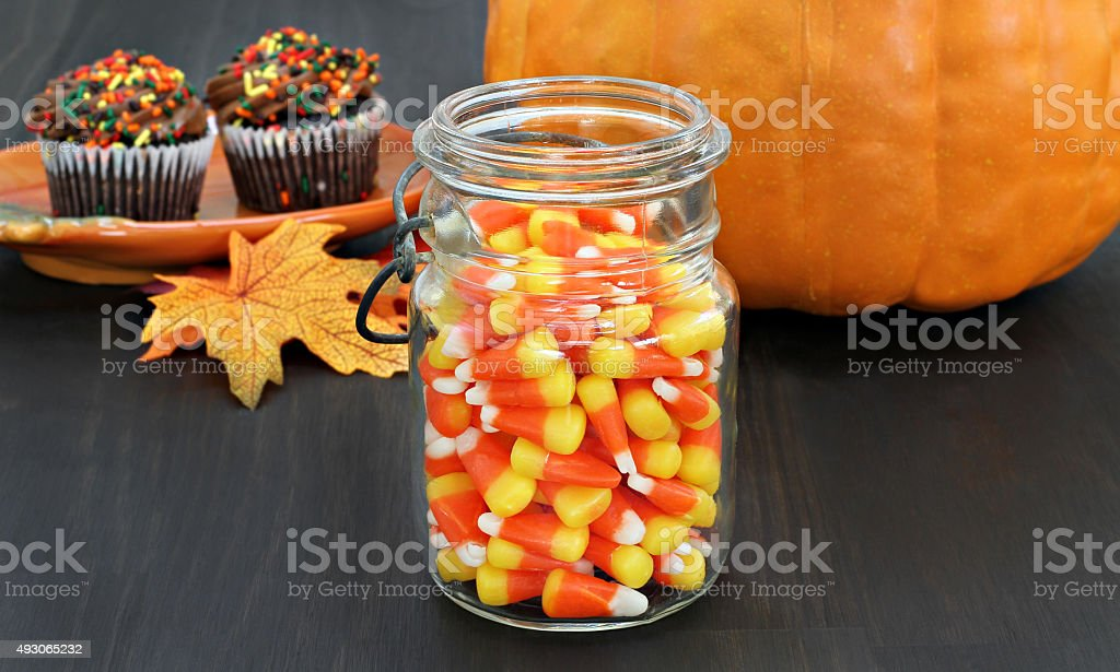 Candy corn in a rustic mason jar. stock photo