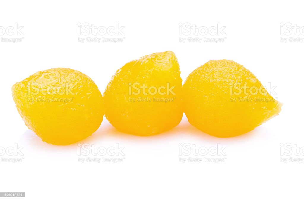 Candy Golden Ball on white background stock photo