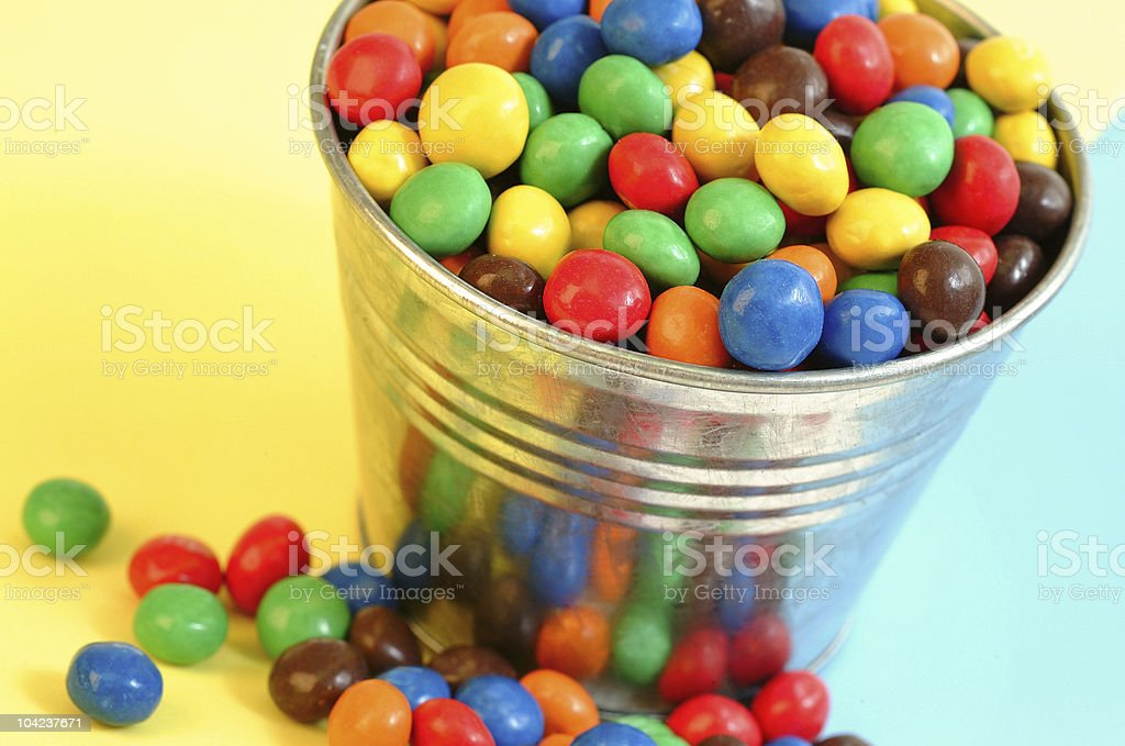 Candy in a bucket stock photo