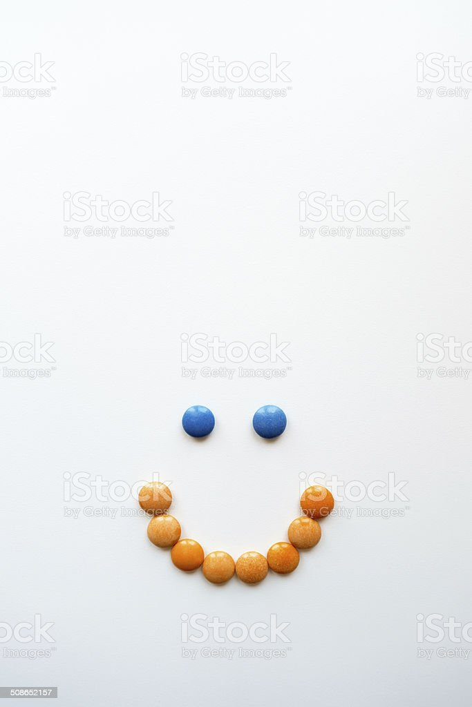 candy smiley face with copy space stock photo