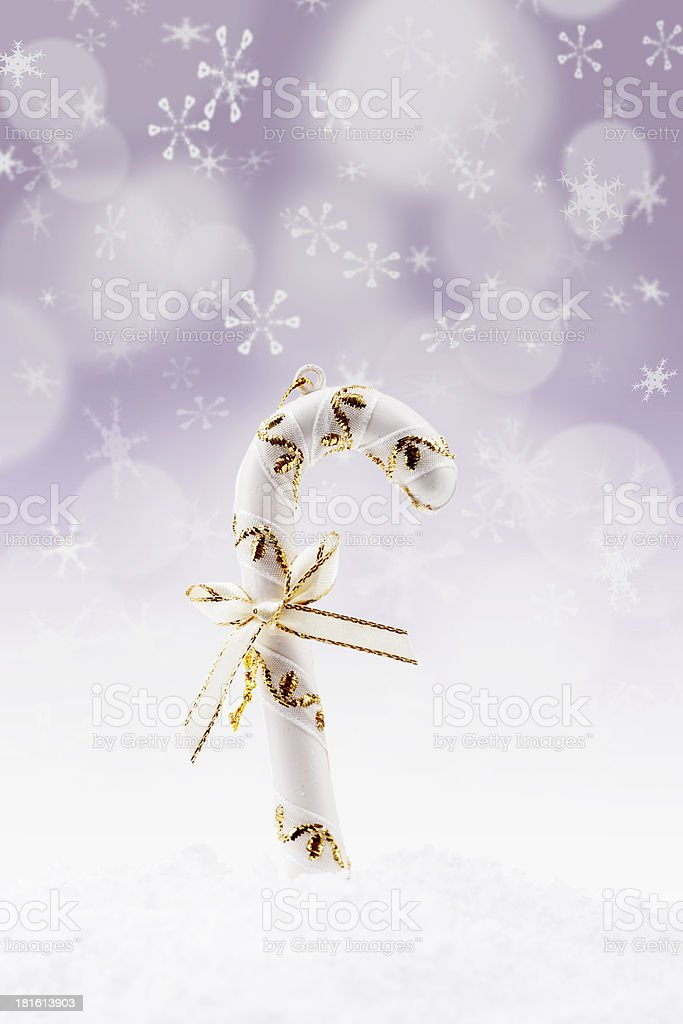 Candy stick for Christmas on defocused lights royalty-free stock photo