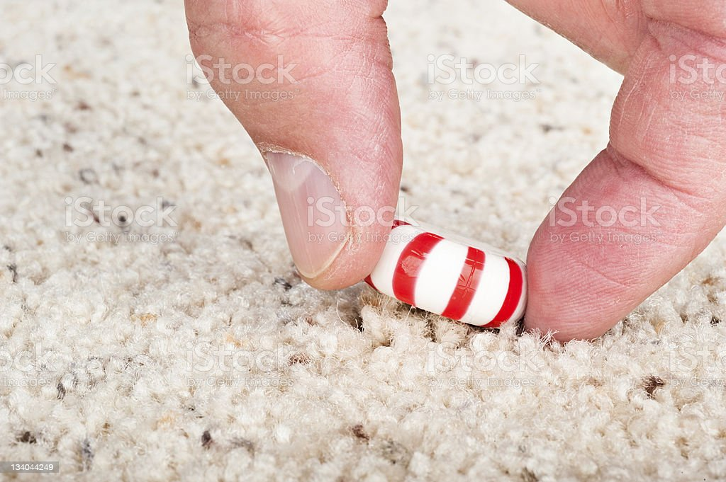 Candy stuck to carpet stock photo
