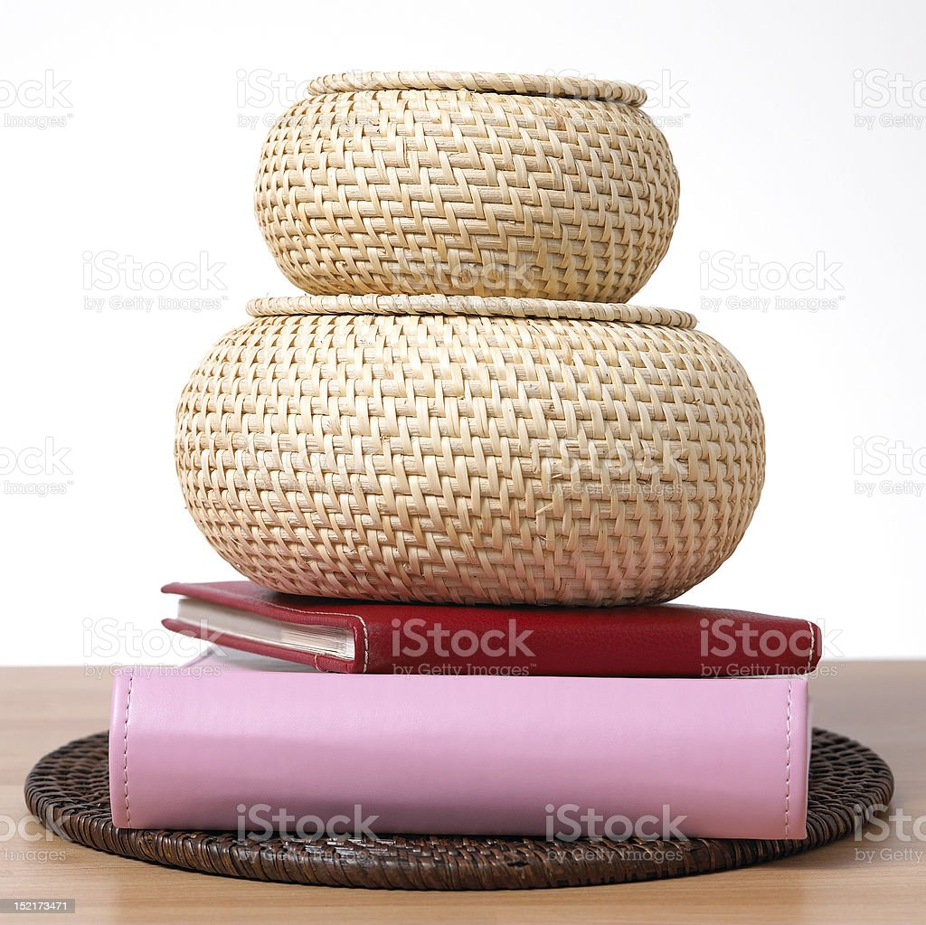 Cane baskets with books and placemat royalty-free stock photo
