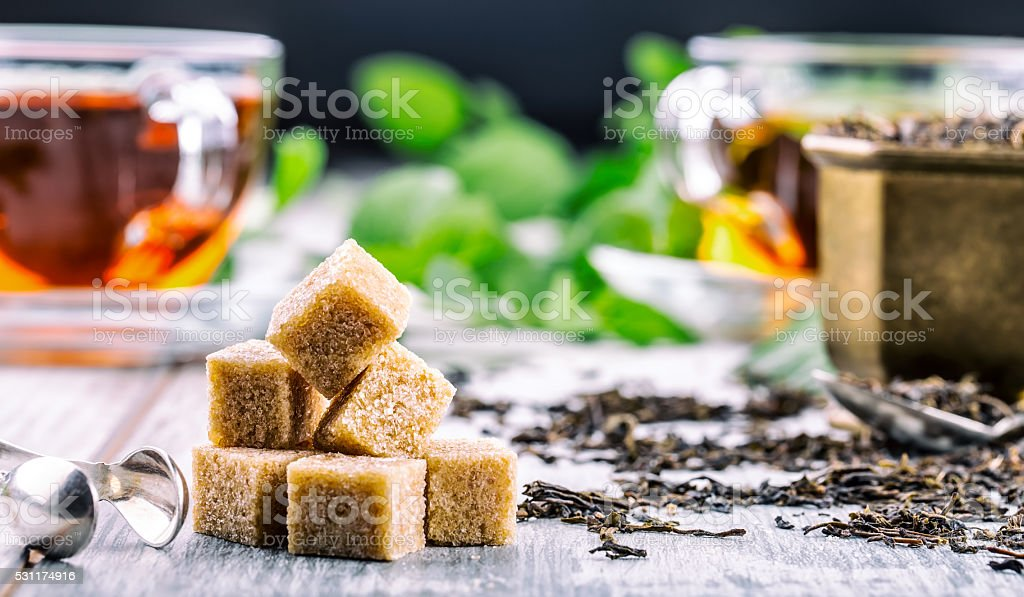 Cane sugar. Cane sugar cubes heap close up macro shot. stock photo
