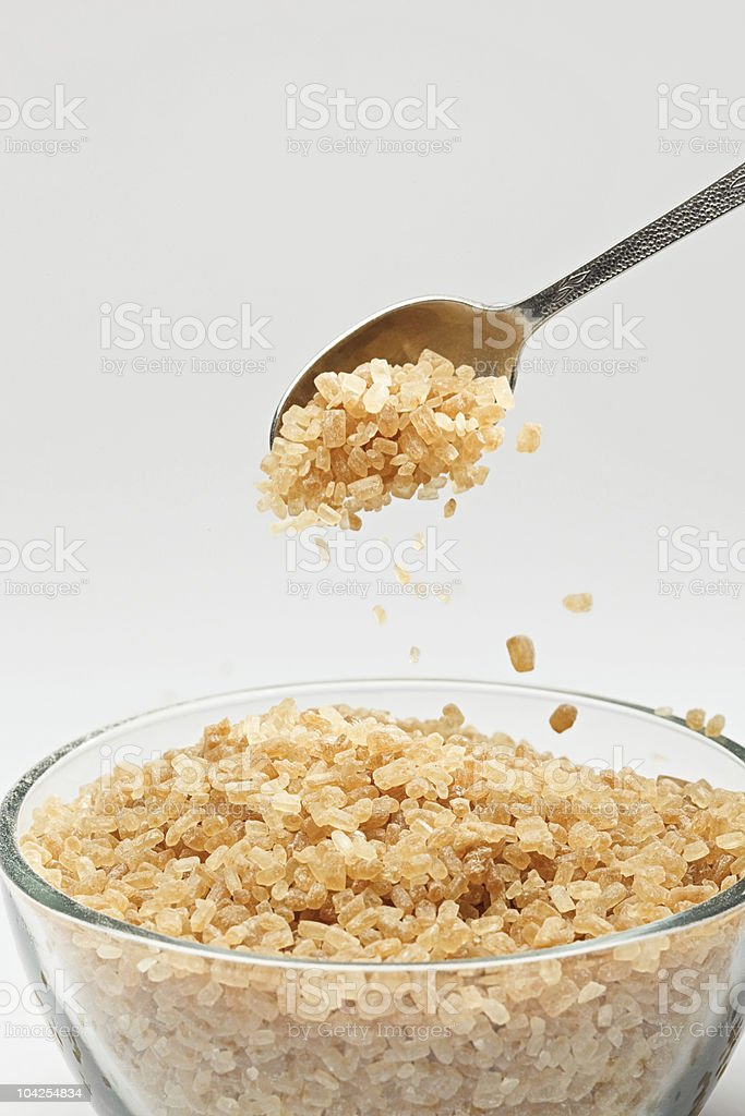Cane sugar falling from a tea-spoon royalty-free stock photo