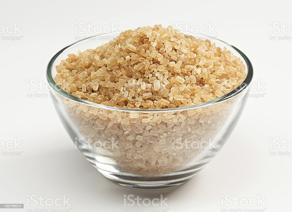 Cane sugar in a glass bowl royalty-free stock photo