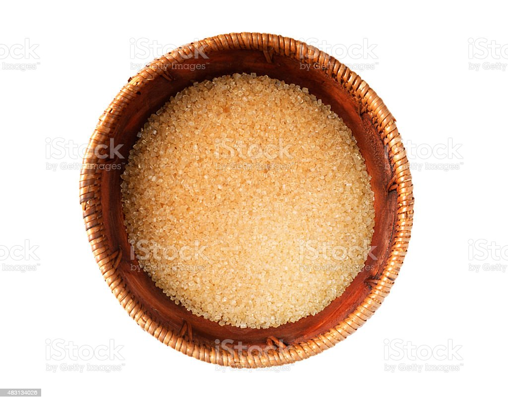 Cane sugar in wooden bowl stock photo